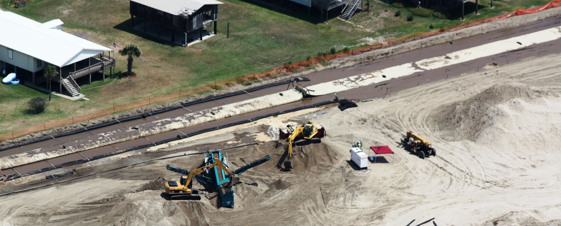 Aerial view of geotextile tube installation operations on Grand Isle, Jefferson Parish, Louisiana