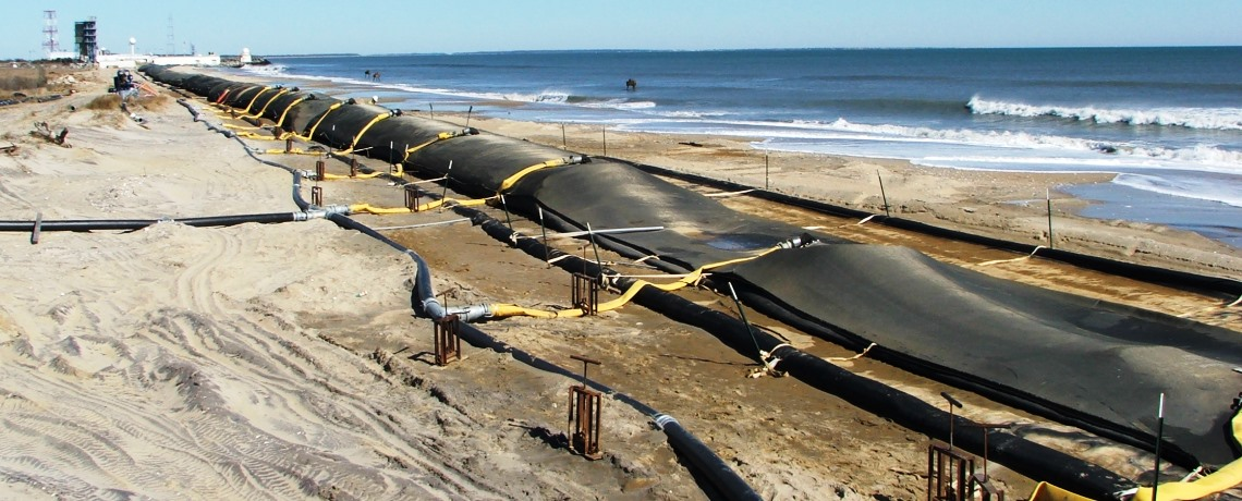 Wallops Island Emergency Shoreline Stabilization, filling geotextile tubes along the shoreline