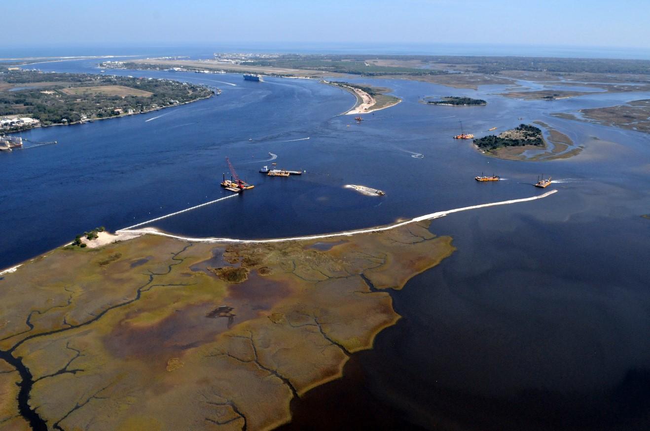 geotextile tube installation on Florida coast