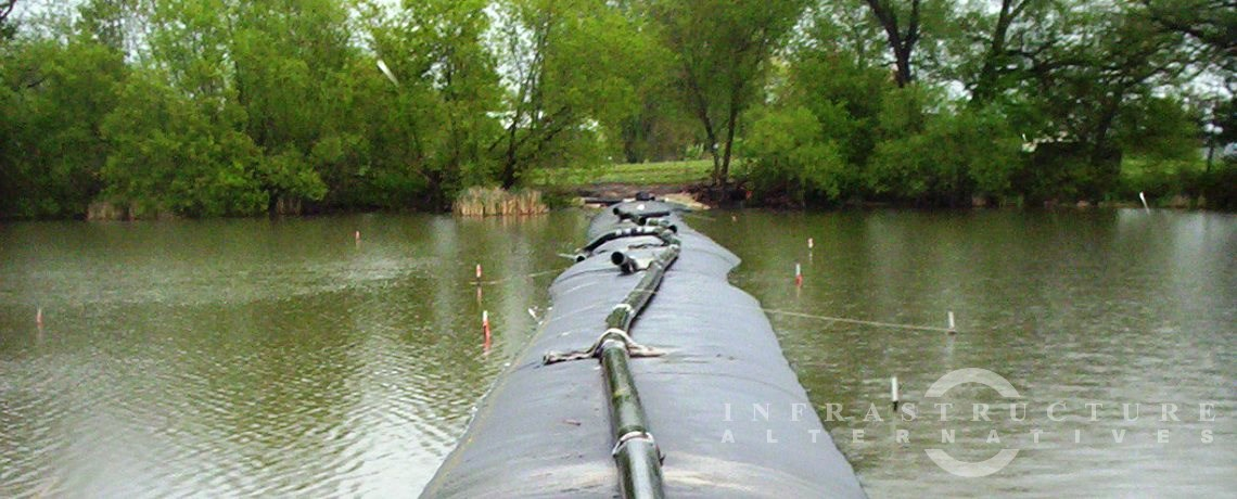 Lake Sinissippi Wetland Rehabilitation project, filling geotextile tubes in the water