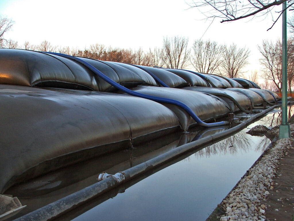 Stacked geotextile tubes used to dewater dredged sediments from the Fond du Lac River and Marina, Fond du Lac, Wisconsin