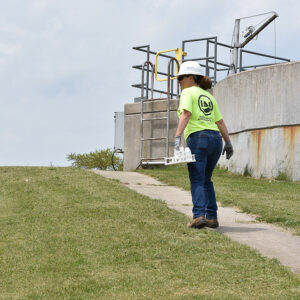 An operator walks through a wastewater treatment facility in Michigan