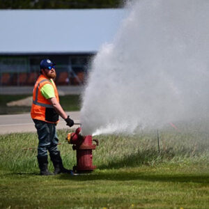 Operator flushing a hydrant, part of a drinking water system in Michigan