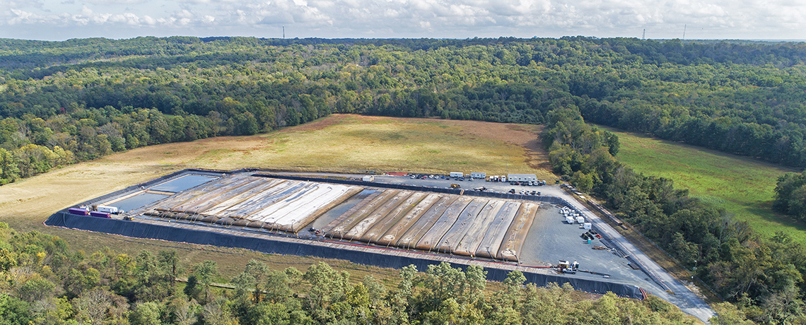 Aerial view of geotextile tube dewatering pad and settling ponds at the Delaware and Raritan Canal Dredging Project in Franklin Township, NJ