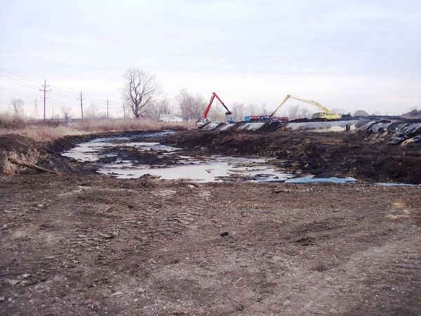 Mechanical excavation to remove some of the sludge