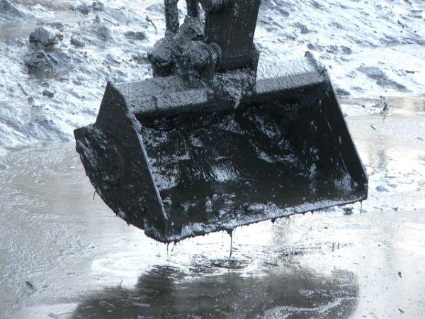 Oily, creosote-contaminated sludge