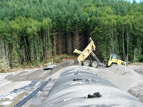 Geotextile tubes, being backfilled