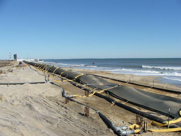 Filling geotextile tubes along Atlantic shore