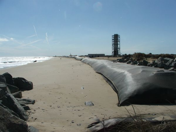 Completed geotextile tube protecting shore