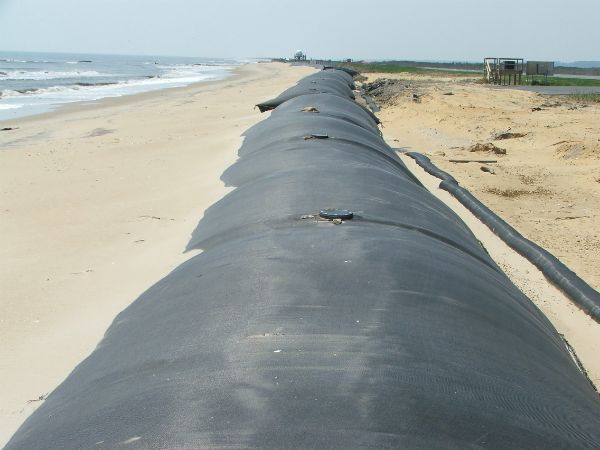 Completed geotextile tube structure on beach