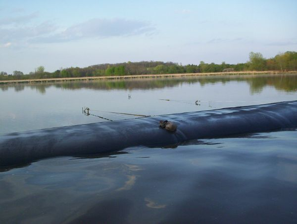Geotextile tube breaking surface of the water