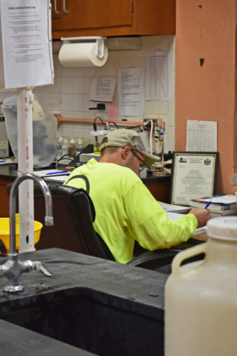 IAI operator at work in the Springbrook Wastewater Plant laboratory