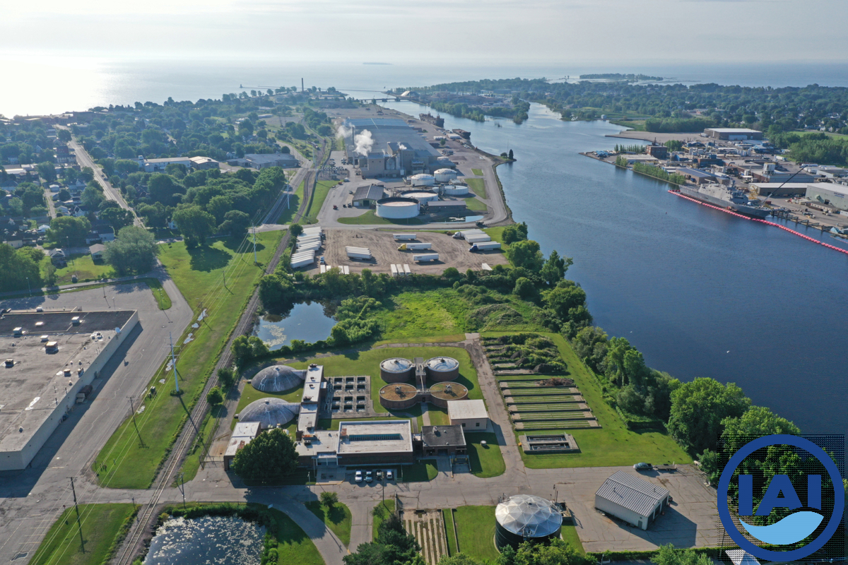 Aerial view of wastewater treatment plant, looking toward Lake Michigan (Menominee River on the right)