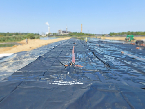 Geotextile tube, deployed, plumbed and ready to be filled with coal ash