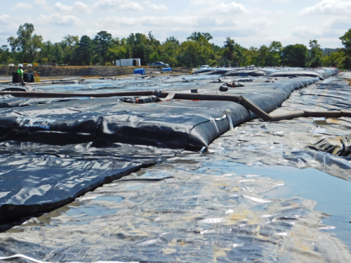 Geotextile tube, deployed, plumbed and beginning to be filled with coal ash