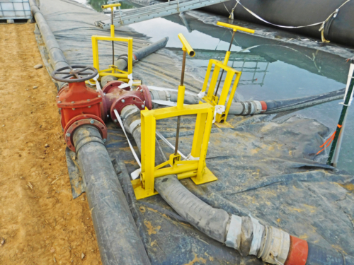 Geotextile tube header and dredged ash flow control valves