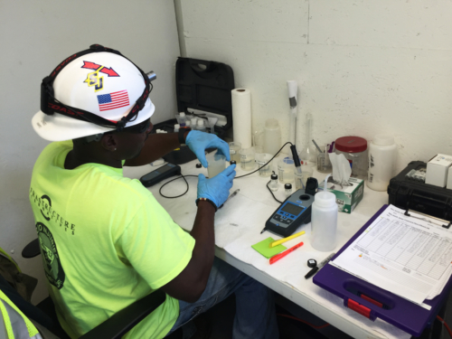 Water treatment operator performing process control tests on site