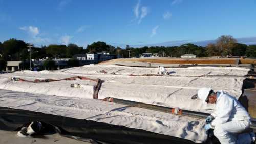 Deploying geotextile tubes over stacked tubes, during second year of operations