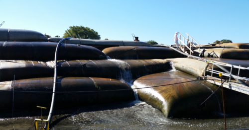 Active dewatering of stacked geotextile tubes, during second year of operations