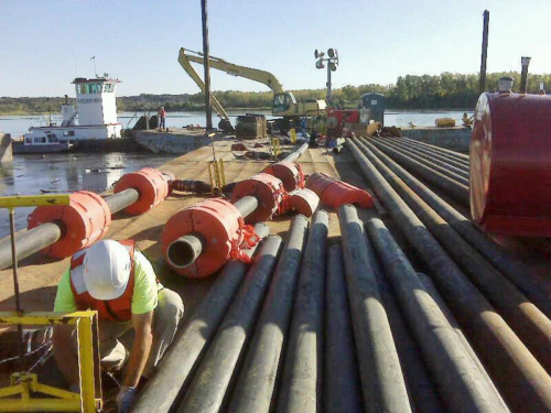 Barge and piping utilized to deploy and fill the geotextile tubes