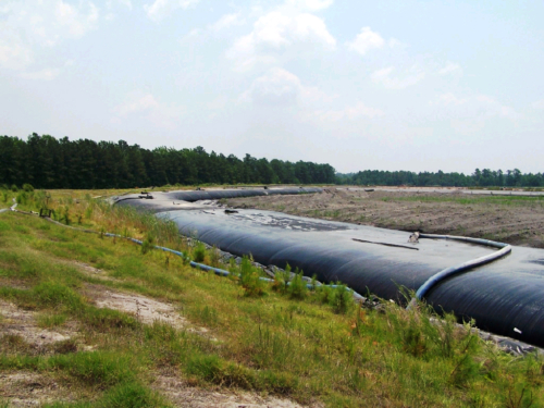 Geotextile tube installed around the corner of the ash pond