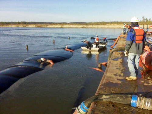 Geotextile tube being filled in the Missouri River