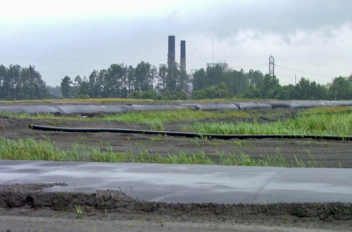 Completed geotextile tubes installed around perimeter of coal ash pond