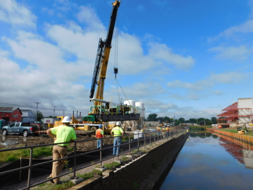 """Launching IAI's 8"""" auger dredge in the canal"""