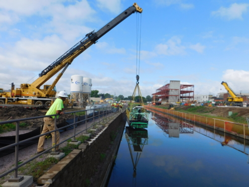 "Launching IAI's 8"" auger dredge in the canal"