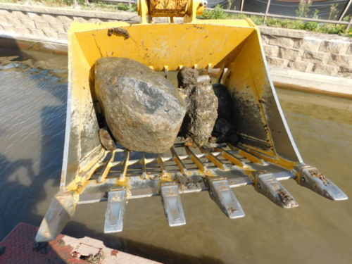 Large debris raked from the canal