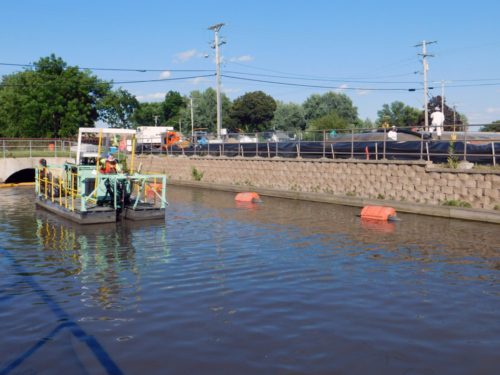 """8"""" auger dredge in canal; geotextile tube dewatering pad"""