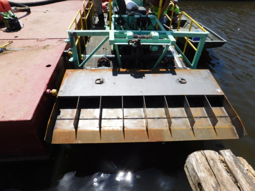 Sand slurry dispersion pan installed on the dredge