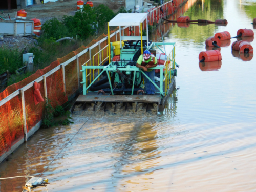 Placing the sand cap in the canal via IAI's custom built sand slurry dispersion system