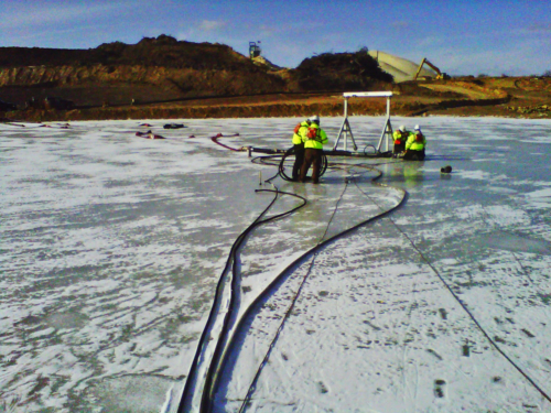 Installing pump and pipeline in the pond, through the ice