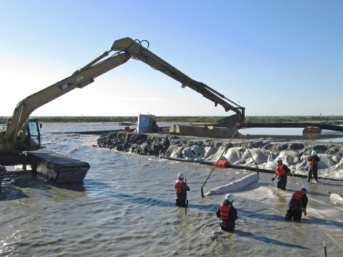 Deploying geotextile tubes in the water