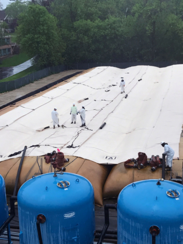 Deploying second layer geotextile tube in TSCA dewatering pad