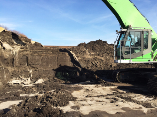 Removing dewatered geotextile tubes and sediment from the site