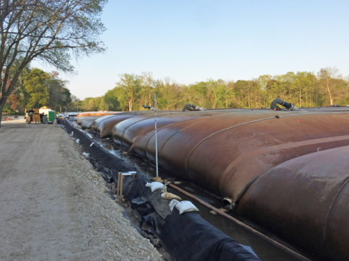 First layer of geotextile tubes in non-TSCA dewatering pad