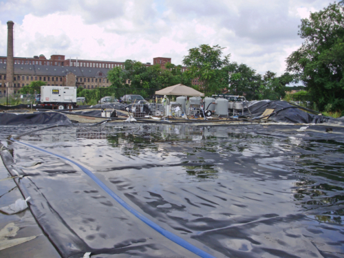 Geotextile tube dewatering pad and water treatment system