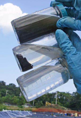 Samples of dredge slurry, conditioned dredge slurry, and water released from geotextile tubes